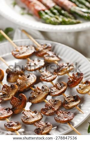 Grilled mushroom skewers - stock photo