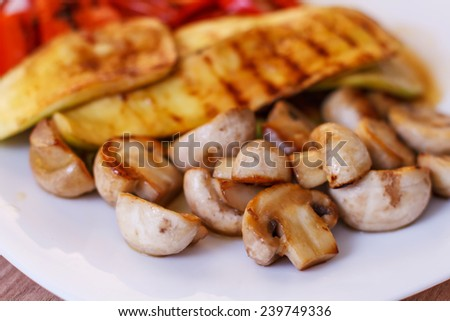 Grilled mushrooms zucchini and red pepper tasty vegetables. - stock photo