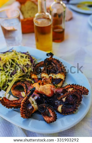 Grilled octopus in greek tavern. - stock photo