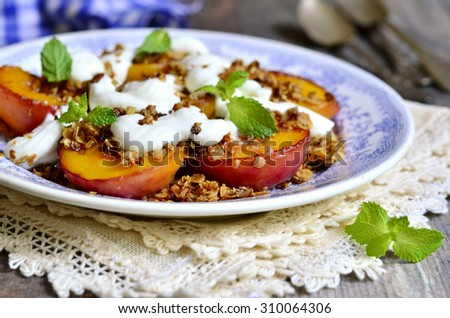 Grilled peaches with granola and whipped cream for breakfast. - stock photo