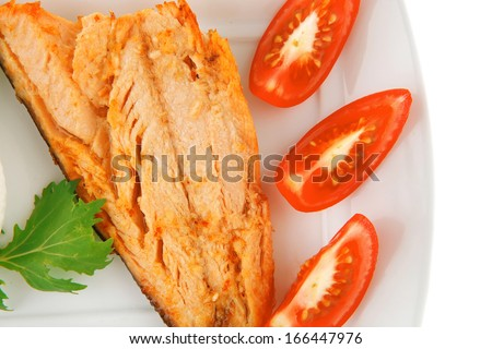 grilled pink salmon fillet with soft cheese on white - stock photo