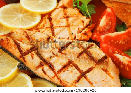 grilled pink salmon with lemon and toasts - stock photo
