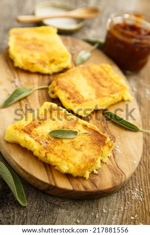 Grilled polenta with barbecue sauce - stock photo