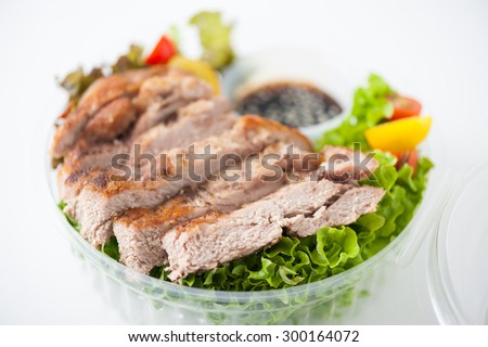 Grilled pork and teriyaki sauce (Japanese sweet sauce) cooked by clean food concept with salad in lunch box