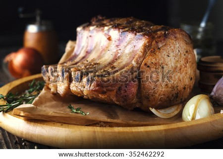 Grilled pork chop on a wooden background - stock photo