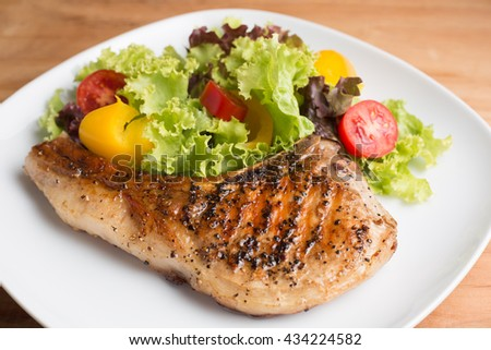 Grilled Pork chop prepare for serve to customer on the table. - stock photo