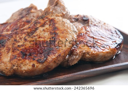 grilled pork chops with seasonings done on the grill - stock photo