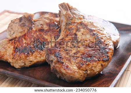grilled pork cops with seasonings done on the grill - stock photo