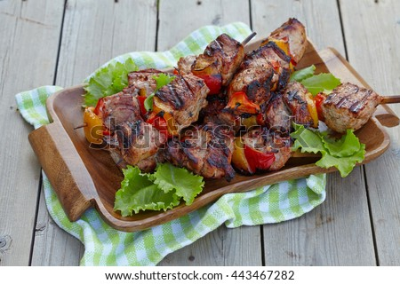 Grilled pork kebab with red and yellow pepper - stock photo