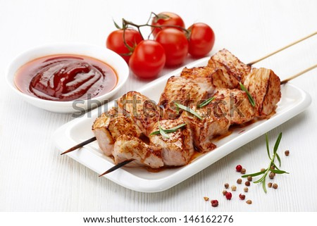grilled pork meat on white plate - stock photo