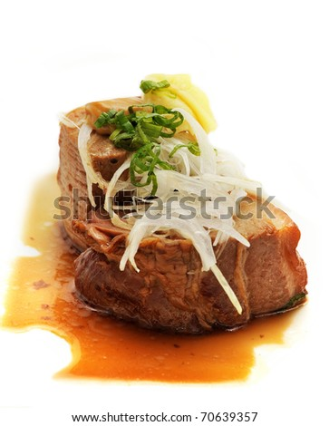 Grilled pork meat with  soy sauce, white onion and ginger - stock photo