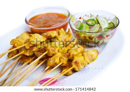 grilled pork satay with peanut sauce and vinegar, thailand. - stock photo