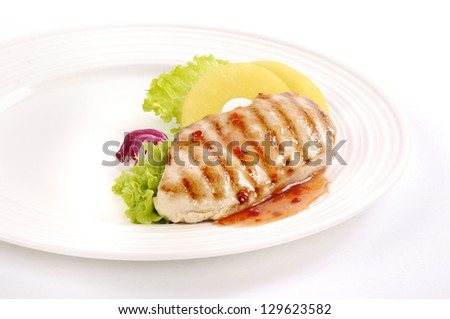Grilled pork steak with green salad on a plate