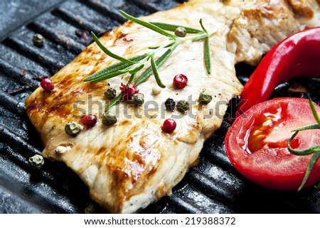 Grilled Pork Steak with Rosemary and Peppercorns - stock photo