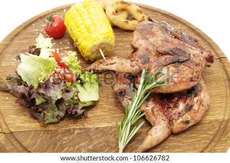 Grilled quail with greens - stock photo
