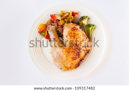 grilled quarter chicken and coocked vegetables - stock photo