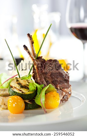 Grilled Rack of Lamb with Mushrooms Sauce and Vegetables - stock photo