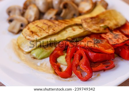 Grilled red pepper zucchini and mushrooms tasty vegetables. - stock photo