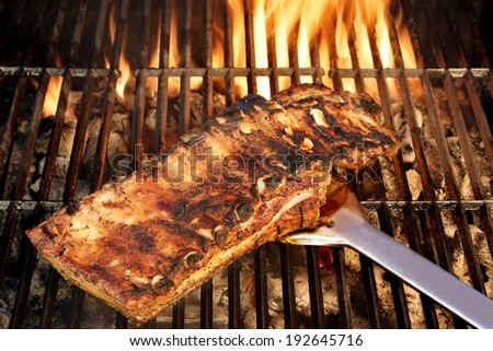 Grilled Ribs on the BBQ Grate. You can see more BBQ food, BBQ Tools, Flaming Grill, Burning&Glowing Coal in my image gallery and public sets.  - stock photo