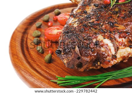 grilled ribs with vegetables on white background