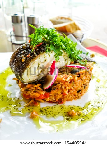 grilled salmon and rice- french dish on the table