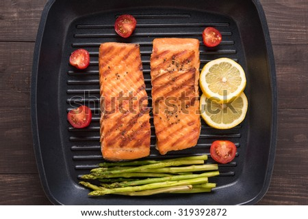 Grilled salmon cooked BBQ on a pan. - stock photo