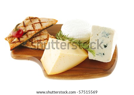 grilled salmon fillet and delicious cheeses on wood