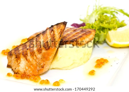 Grilled salmon fillet with vegetables and caviar - stock photo