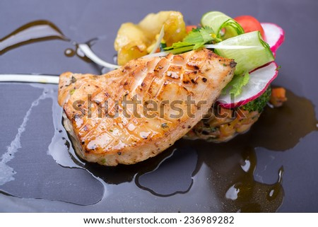 Grilled salmon fish steak with vegetable salad - stock photo