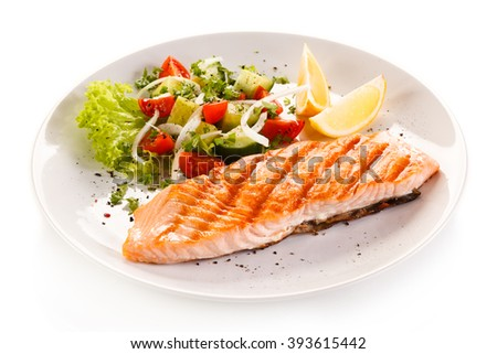 Grilled salmon steak and vegetables  - stock photo