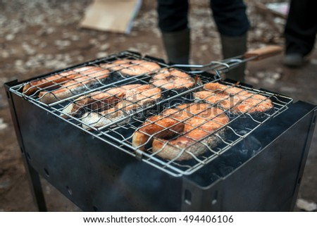 Grilled salmon steak on the barbecue.