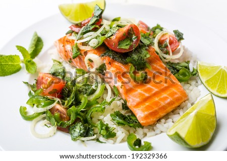 Grilled Salmon Steak with Rice and Tomato, Mint, Coriander and Lime Salsa - stock photo