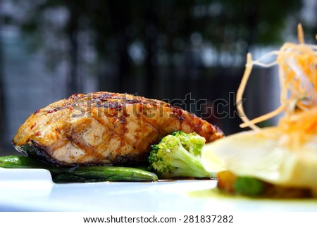 Grilled salmon steak with vegetables                   - stock photo