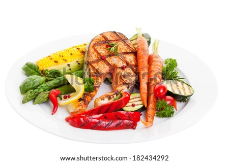 Grilled salmon steak with vegetables corn and asparagus - stock photo
