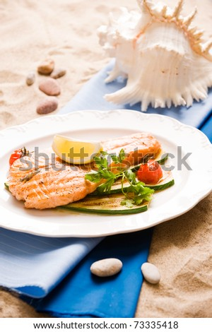 Grilled Salmon Steak With Vegetables. Shallow depth Of field - stock photo