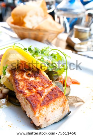 Grilled Salmon - with fresh lettuce and lemon - stock photo