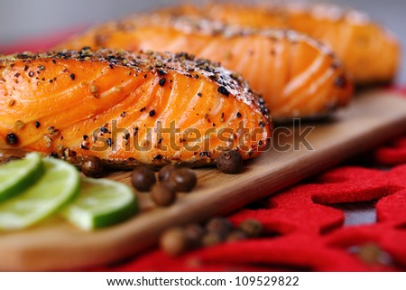 Grilled salmon with lime and pepper. - stock photo