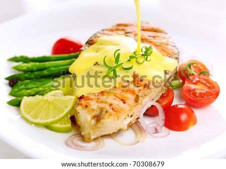 Grilled salmon with lime, asparagus and saffron sauce with rosemary - stock photo