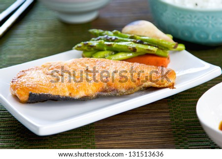 Grilled Salmon with saut�©ed vegetables,rice and Miso soup - stock photo
