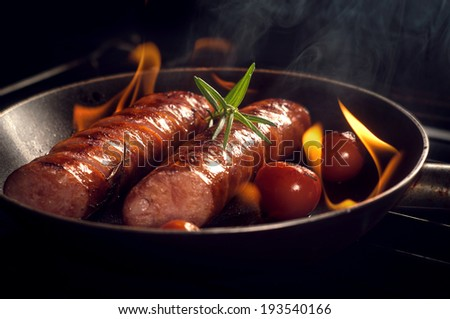 grilled sausage with cherry tomatoes - stock photo