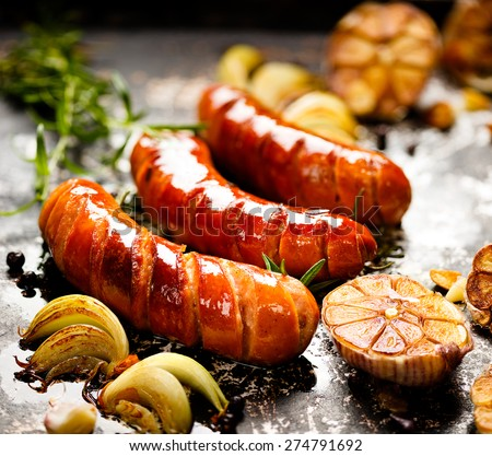 Grilled sausage with garlic and onions - stock photo