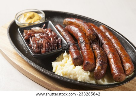 grilled sausage with mashed potatoes - stock photo