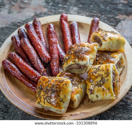 Grilled sausages and sausage rolls - stock photo
