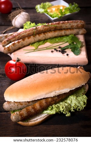Grilled sausages in the bun,selective focus  - stock photo