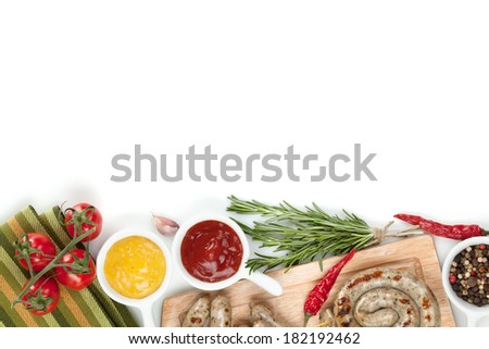 Grilled sausages with ketchup and mustard. Isolated on white background - stock photo