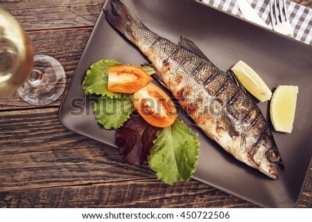 Grilled sea bass on the plate.