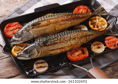 Grilled sea fish and vegetables in a pan grill closeup. horizontal - stock photo