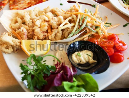 Grilled Seafood and vegetables with salad and tomatoes - stock photo