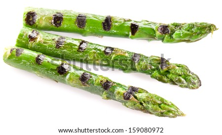 Grilled shoots of asparagus isolated on a white background. - stock photo