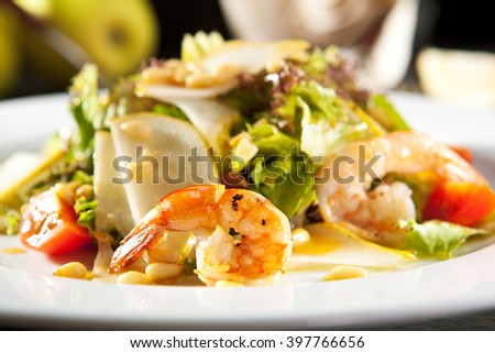 Grilled Shrimp and Pear Salad with Pine Nut Dressing - stock photo